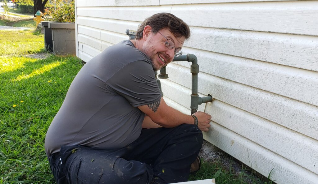 Brothers' Plumber installing a Residential Gas Line.